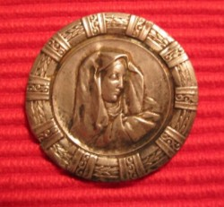 Silver ornamental disc pin