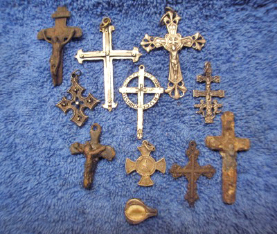 Silver and bronze religious crosses